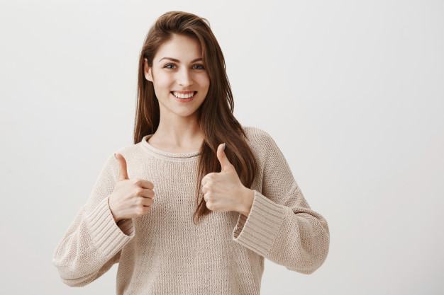 satisfied-girl-showing-well-done-thumbs-up-gesture-smiling-pleased_176420-20741