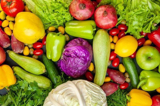 top-view-vegetables-fruits-zucchini-bell-peppers-apples-quince-cherry-tomatoes-cumcuat-parsley-cabbage-lemon-pomegranates_140725-59438