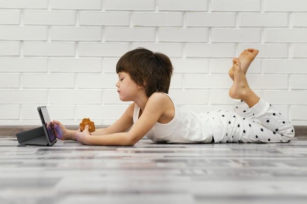 full-shot-kid-sitting-floor_23-2148823877